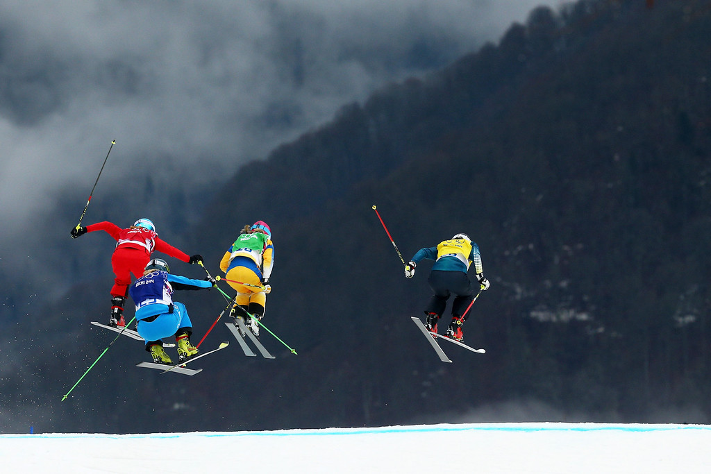 . (L-R) Jorinde Mueller of Switzerland, Andrea Limbacher of Austria, Sandra Naeslund of Sweden and Jenny Owens of Australia compete in the Freestyle Skiing Womens\' Ski Cross 1/8 Finals on day 14 of the 2014 Winter Olympics at Rosa Khutor Extreme Park on February 21, 2014 in Sochi, Russia.  (Photo by Cameron Spencer/Getty Images)