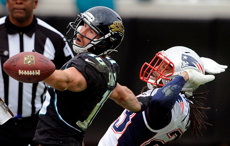 . Jacksonville Jaguars wide receiver Jordan Shipley (16) misses a pass while defended by New England Patriots defensive back Marquice Cole (23) during the second half of an NFL football game on Sunday, Dec. 23, 2012, in Jacksonville, Fla. The Patriots defeated the Jaguars 23-16. (AP Photo/Stephen Morton)