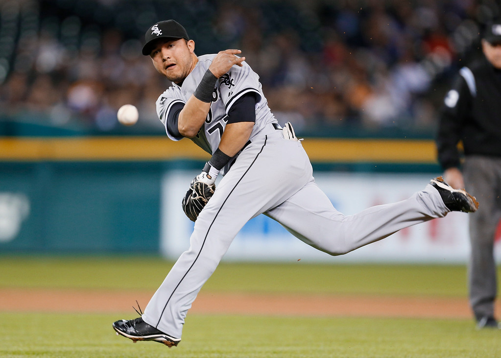 . Chicago White Sox second baseman Carlos Sanchez throws Detroit Tigers\' Andrew Romine out in the fourth inning of a baseball game in Detroit Monday, Sept. 22, 2014. (AP Photo/Paul Sancya)