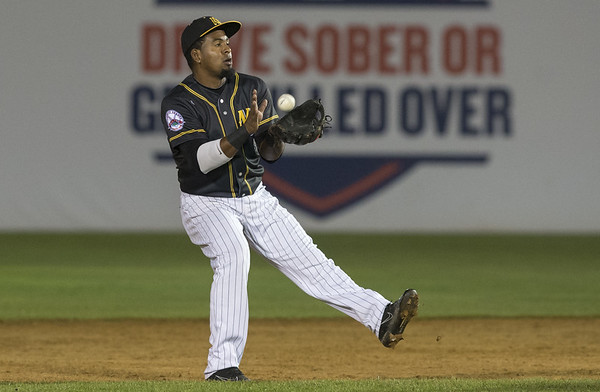 The New Britain Bees vs the Lancaster Barnstormers on Friday night at New Britain Stadium. Second baseman Rando Moreno (4) with a basket catch. | Wesley Bunnell | Staff