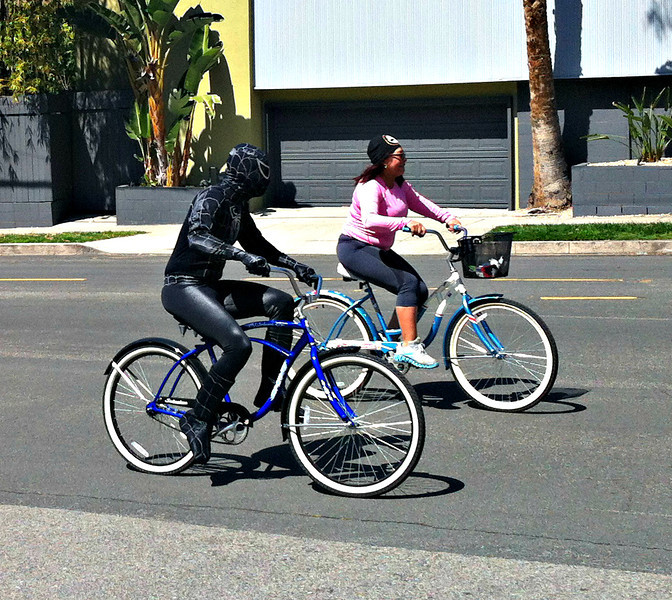 Bicycling spiderman. Perfectly normal.