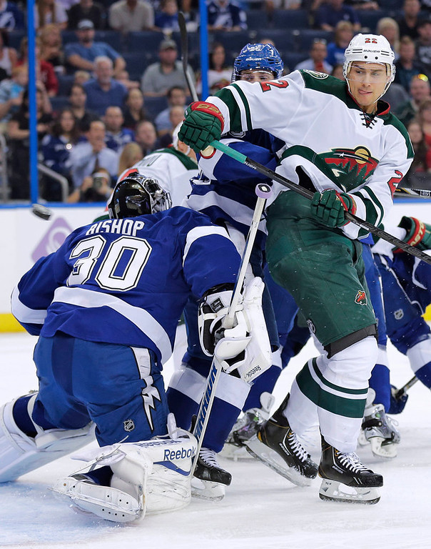 . Minnesota Wild right wing Nino Niederreiter (22), of the Czech Republic, deflects the puck over Tampa Bay Lightning goalie Ben Bishop (30) during the first period. (AP Photo/Chris O\'Meara)