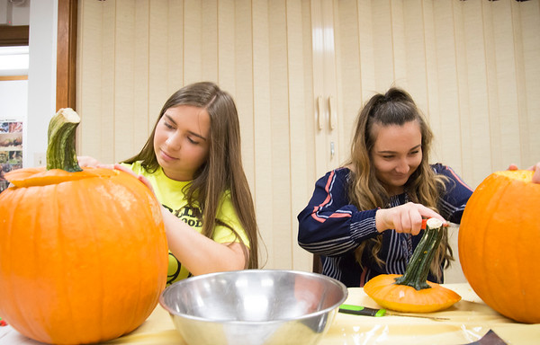 10/14/19 Wesley Bunnell | Staff Volunteers, many of them high school students and members of the Interact Club, carved pumpkins for the upcoming lighted jack-o-lantern trail walk coming up this Friday October 18th and October 19th at Hungerford Nature Center. Gina Scalaro, L, and Stefanie Poulin, both Interact Club members carve pumpkins.