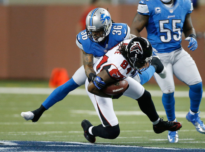 . Roddy White #84 of the Atlanta Falcons is tackled after a first quarter catch by Jonte Green #36 of the Detroit Lions at Ford Field on December 22, 2012 in Detroit, Michigan. (Photo by Gregory Shamus/Getty Images)