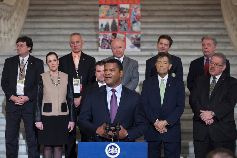 Marcus Jadotte, VP of Public Affairs and Multicultural Development, NASCAR speaking at a press conference in the PA Capitol Rotunda on March 10, 2014. Standing Left to Right - Rep. Mike Carroll; Sen. Lisa Baker; Rep. Sid Kavulich; Brandon Igdalsky, President & CEO of Pocono Raceway; Rep. Mario Scavello; Rep. Jerry Stern; C.J. O'Donnell, Chief Marketing Officer, Hulman Sports; Rep. John Payne; and Sen. Tim Sollobay