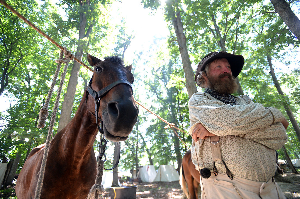 ". Bob Green of Polo, Mo a member of ""Elliot Scouts\"" 9th Missouri Cavalry Co. B and his favortie horse, Ringo, relax at the Confederate Cavalry camp at the Blue Gray Alliance re-enactment at the Bushey Farm on June 29, 2013. LEBANON DAILY NEWS - JEREMY LONG"