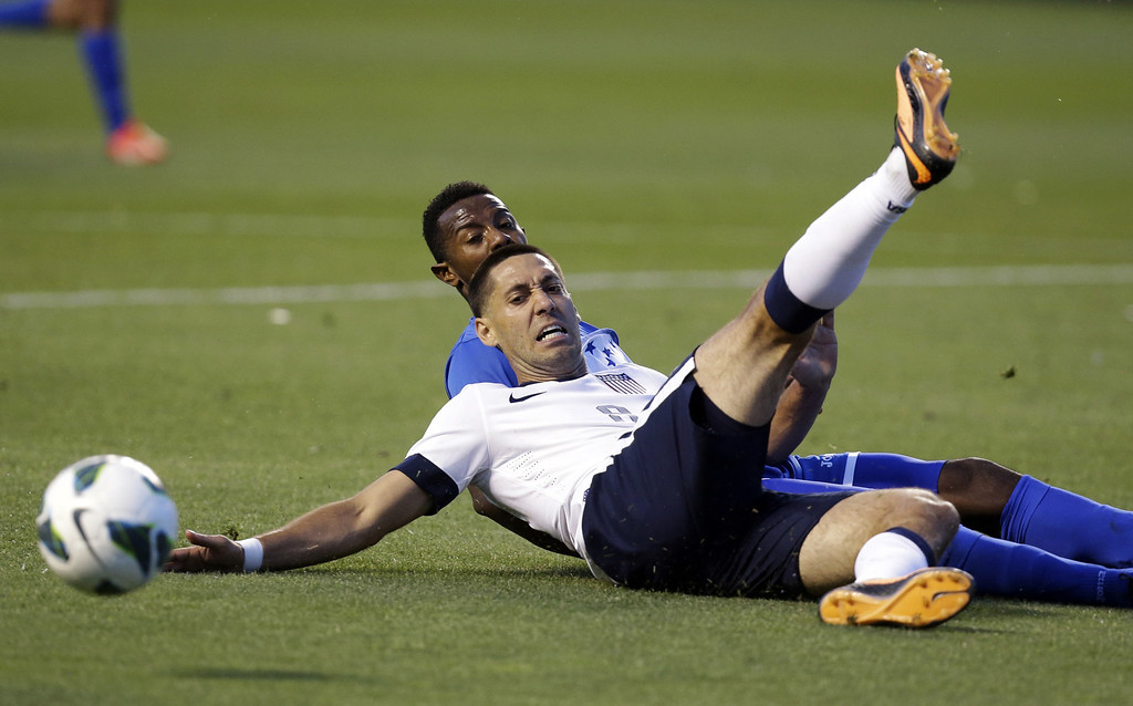 . Honduras\' Jose Velasquez, rear, and United States\' Clint Dempsey battle for a ball in the second half during a World Cup qualifying soccer match at Rio Tinto Stadium on Tuesday, June 18, 2013, in Sandy, Utah. The United States defeated Honduras 1-0.  (AP Photo/Rick Bowmer)