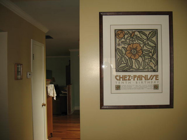 Beautiful Chez Panisse Tenth Birthday poster in our kitchen, looking towards the foyer.