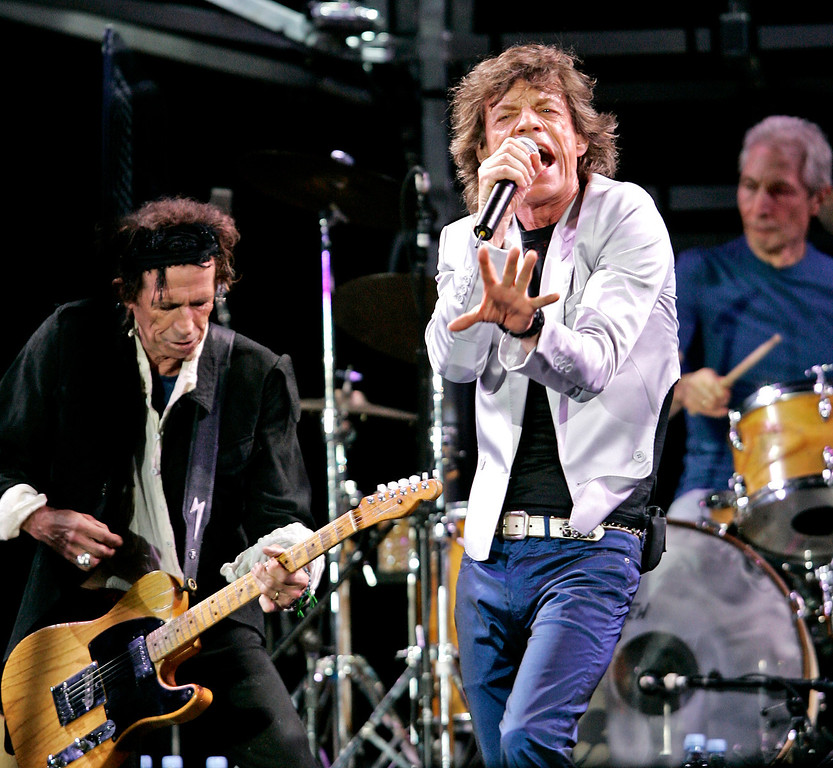 ". Rolling Stones, from left, Keith Richards, Mick Jagger and Charlie Watts, perform at Fenway Park in Boston Sunday, Aug. 21, 2005, where the they opened their ""A Bigger Bang\"" world tour. (AP Photo/Winslow Townson)"