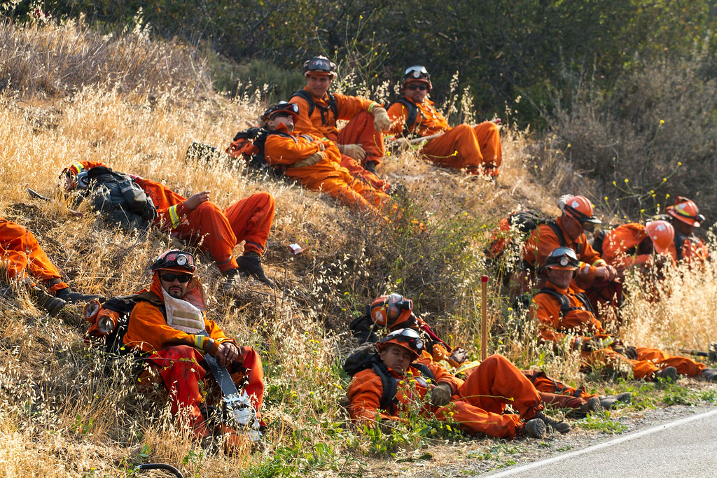 . Members of handcrew take a rest along a hillside in Hidden Valley, Calif., Saturday, May 4, 2013. High winds and withering hot, dry air was replaced by the normal flow of damp air off the Pacific, significantly reducing fire activity.  (AP Photo/Ringo H.W. Chiu)