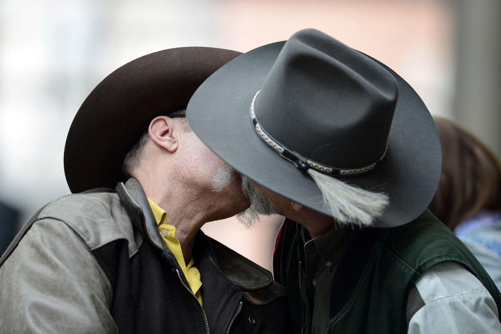 . DENVER, CO. - MARCH 21: Steve Unfer of Black Hawk, left, and his partner Rich Jaeger celebrate after Colorado Gov. John Hickenlooper signed Senate Bill 11 legalizing civil unions at History Colorado Center on Thursday March 21, 2013. (Photo By Hyoung Chang/The Denver Post)
