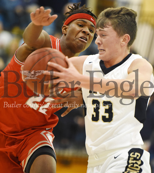 Harold Aughton/Butler Eagle: Knoch's Jack Schiedt, 33, drives past Chaney's Quincy Jones, 22, in an exhibition game at Butler High School, Friday, Dec. 6, 2019.