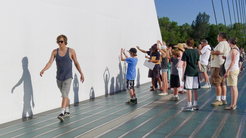 Making shadows on the Sundial Bridge. By crossing fingers, people created small holes to show the crescent shape of the sun as the solar eclipse progressed.