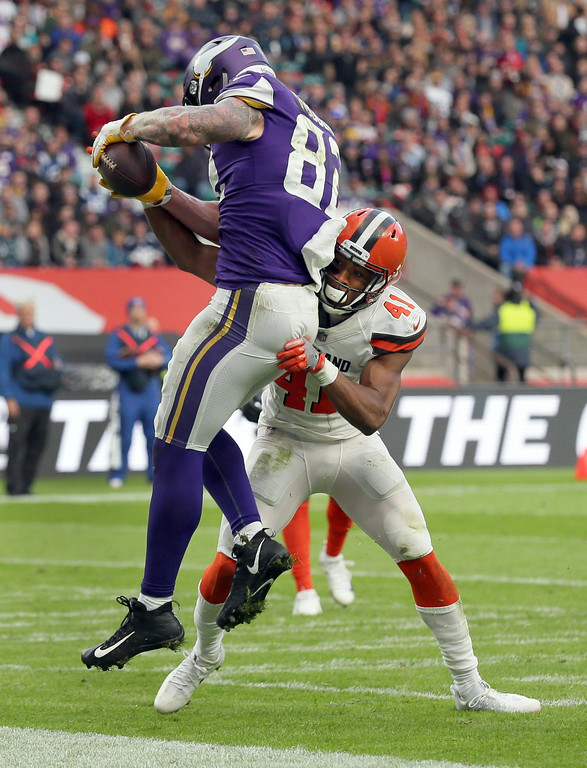 . Minnesota Vikings tight end Kyle Rudolph, left, catches a 4-yard touchdown pass as Cleveland Browns cornerback Mike Jordan (41) defends during the second half of an NFL football game at Twickenham Stadium in London, Sunday Oct. 29, 2017. (AP Photo/Tim Ireland)