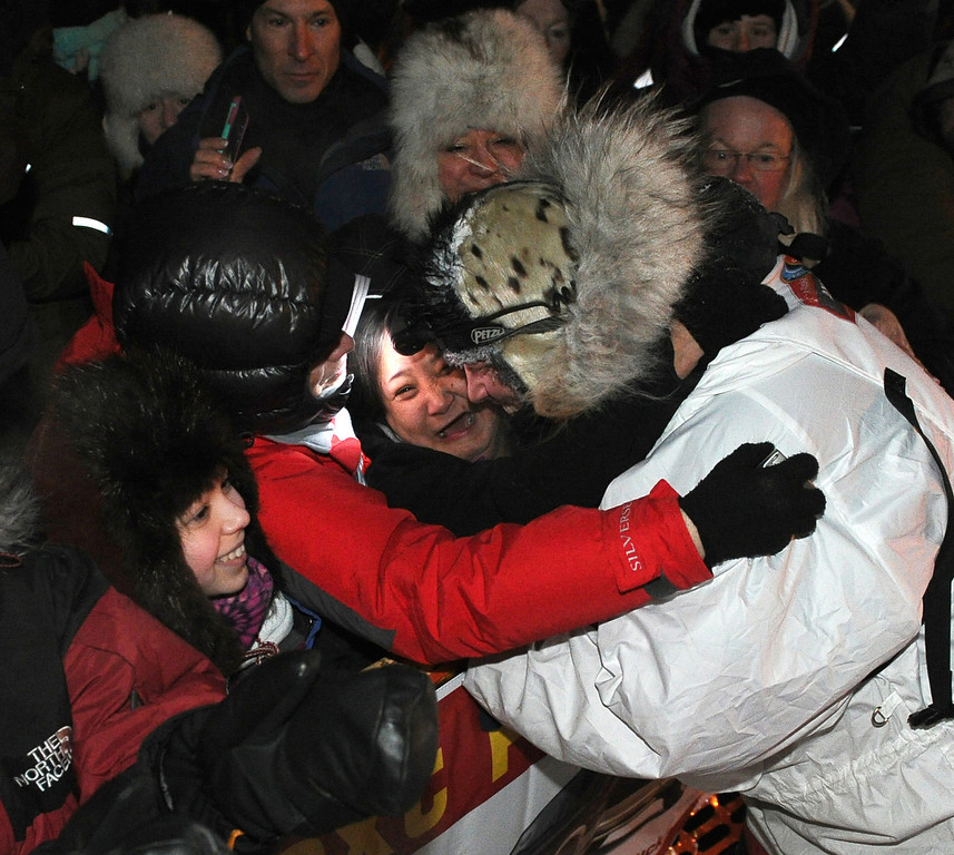 . Aliy Zirkle, right,  gets a hug from Krista Seidelmann, of Nome, after finishing in second place behind race winner Dallas Seavey in the 2014 Iditarod Trail Sled Dog Race, Tuesday, March 11, 2014 in Nome, Alaska (AP Photo/The Anchorage Daily News, Bob Hallinen)