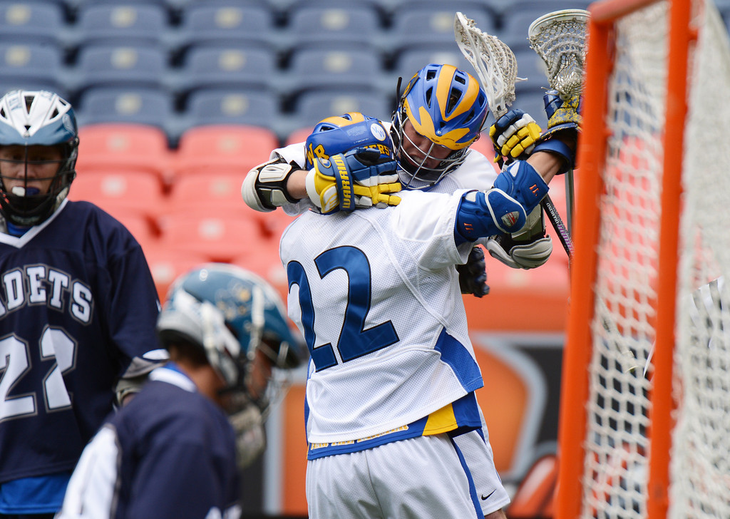 . DENVER, CO. - MAY 18 : Josh Kaufling of Wheat Ridge High School (24), top, celebrates his scoring during 4A Boy\'s Lacrosse Championship game against Air Academy High School at Sports Authority Field at Mile High Stadium. Denver, Colorado. May 18, 2013. (Photo By Hyoung Chang/The Denver Post)