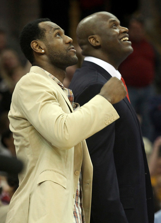 . Michael Allen Blair/MBlair@News-Herald.com The Cavs LeBron James and Shaquille O\'Neal look up at the scoreboard screen and laugh during Sunday\'s game at The Q.