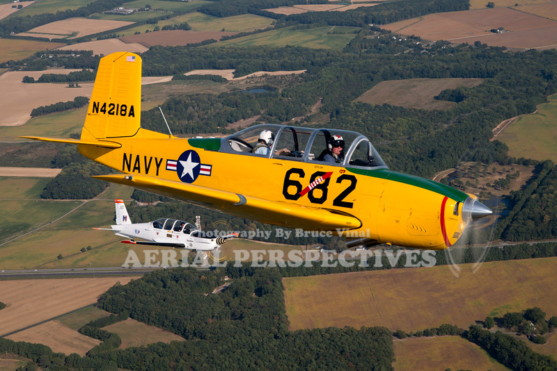 See more images from this flight here  https://www.aerialperspectives.org/Airshows-By-Year/2019-Airshows/Easton-Airport-Day-Chicken-Drop/T-34s/