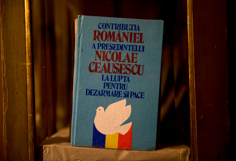 ". A picture taken on Dec. 15, 2014 shows books and magazines, either about or allegedly authored by communist dictator Nicolae Ceausescu, at the military garrison, turned museum, in Targoviste, Romania, where he and his wife Elena spent their final days before being executed on Dec. 25, 1989.Title reads ""Romania\'s and Nicolae Ceausescu\'s contribution to the fight for disarmament and peace\"".  (AP Photo/Vadim Ghirda)"
