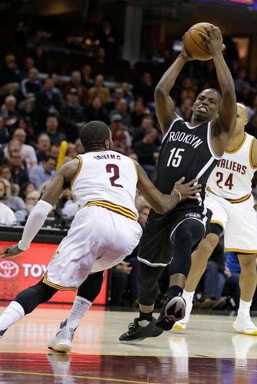 . Brooklyn Nets\' Isaiah Whitehead (15) drives past Cleveland Cavaliers\' Kyrie Irving (2) during the first half of an NBA basketball game, Friday, Jan. 27, 2017, in Cleveland. (AP Photo/Tony Dejak)