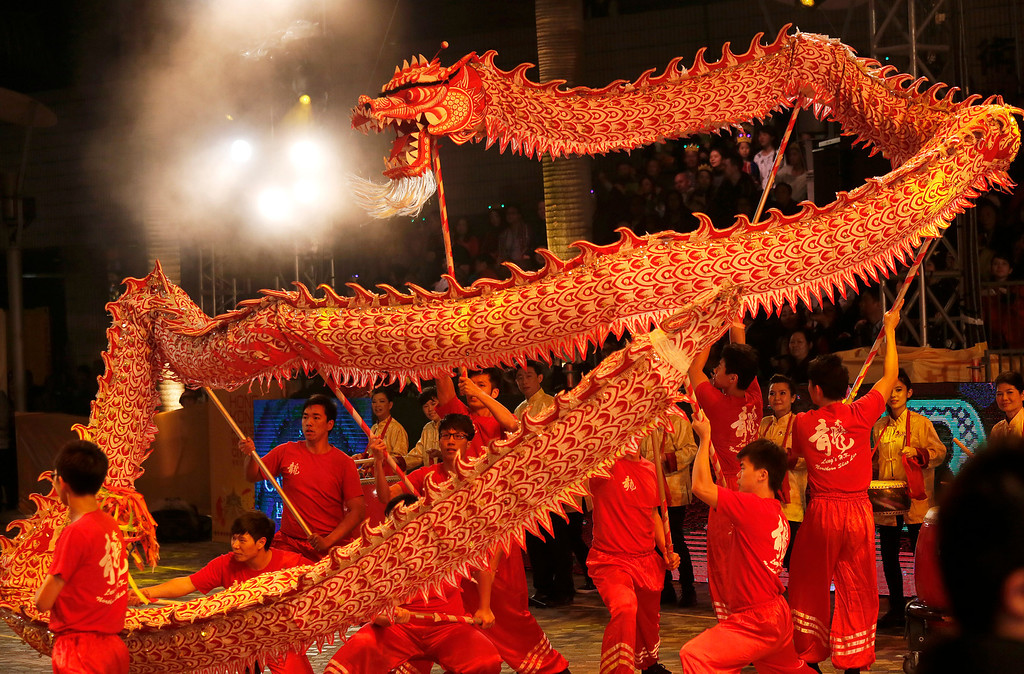 . Performers show dragon dance during a night parade to celebrate Chinese New Year in Hong Kong, Friday, Jan. 31, 2014.  (AP Photo/Vincent Yu)