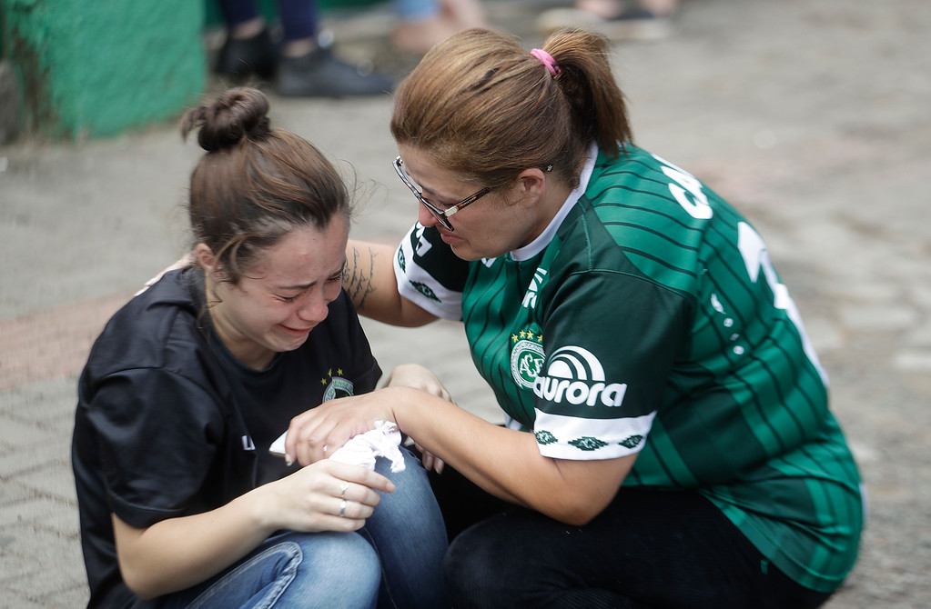 . A fan of Brazil\'s soccer team Chapecoense consoles another outside the Arena Conda stadium in Chapeco, Brazil, Tuesday, Nov. 29, 2016. A chartered plane that was carrying the Brazilian soccer team to the biggest match of its history crashed into a Colombian hillside and broke into pieces, killing 75 people and leaving six survivors, Colombian officials said Tuesday. (AP Photo/Andre Penner)