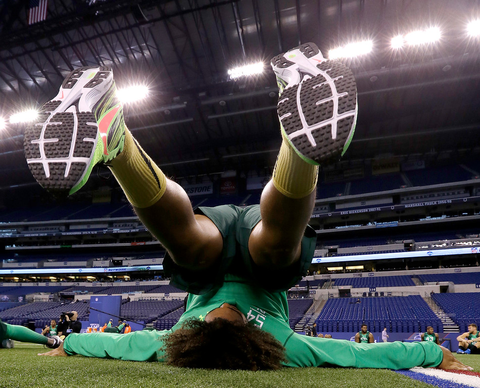 . USC defensive lineman Leonard Williams stretches before drills at the NFL football scouting combine in Indianapolis, Sunday, Feb. 22, 2015. (AP Photo/Julio Cortez)