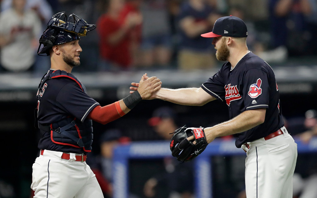 . Cleveland Indians relief pitcher Cody Allen, right, is congratulated by catcher Yan Gomes after the Indians defeated the Chicago White Sox 6-3 in a baseball game, Tuesday, June 19, 2018, in Cleveland. (AP Photo/Tony Dejak)