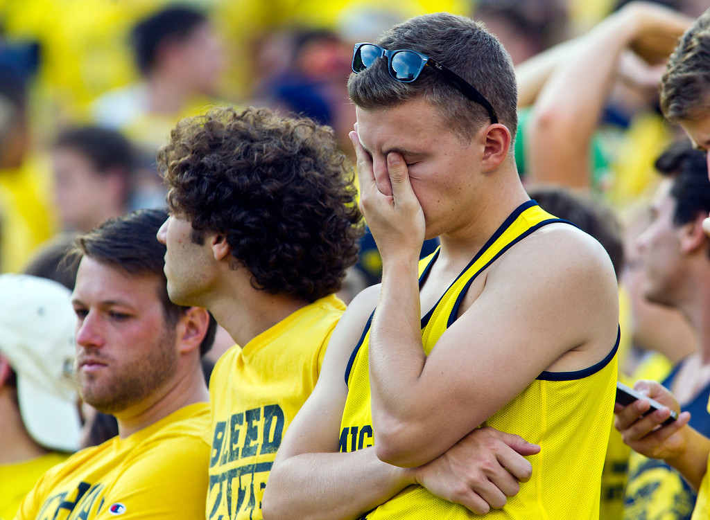 . Michigan fans in the student section react in the fourth quarter of an NCAA college football game against Minnesota in Ann Arbor, Mich., Saturday, Sept. 27, 2014. Minnesota won 30-14. (AP Photo/Tony Ding)