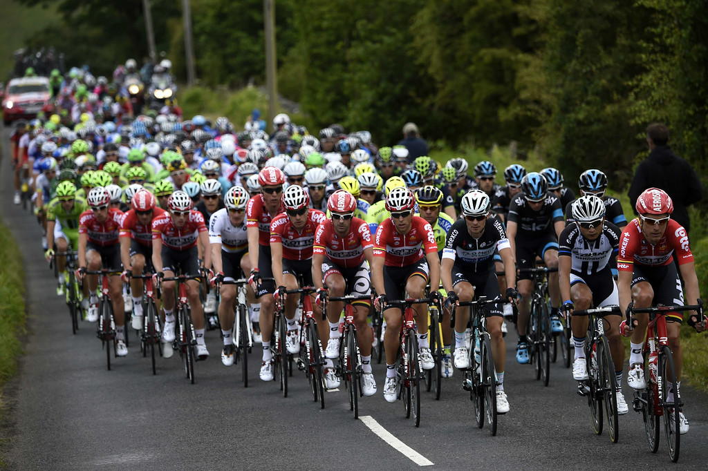 . The pack rides during the 190.5 km first stage of the 101st edition of the Tour de France cycling race on July 5, 2014 between Leeds and Harrogate, northern England.  The 2014 Tour de France gets underway on July 5 in the streets of Leeds and ends on July 27 down the Champs-Elysees in Paris. ERIC FEFERBERG/AFP/Getty Images