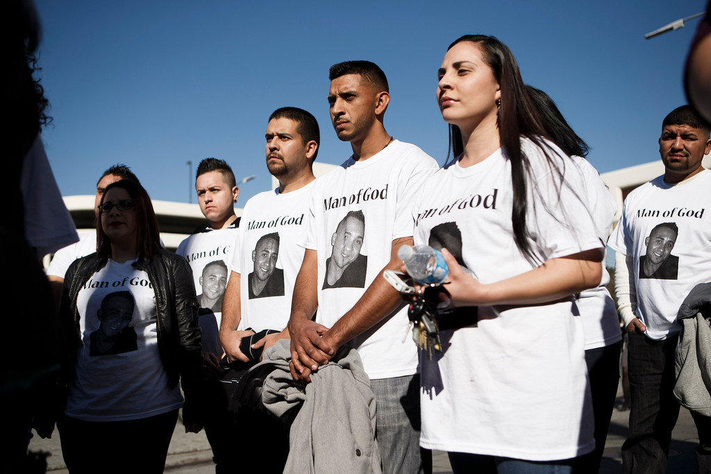 . Supporters for Luis Ricardo Hernandez, the apartment complex maintenance worker who allegedly shot to death a man he suspected of committing a series of burglaries at the apartment complex, stand by as a Hernandez\'s relative speaks to the media in front of the Santa Clara County Hall of Justice prior to Hernandez\'s court appearance on Jan. 18, 2013 in San Jose. (Dai Sugano/Staff)