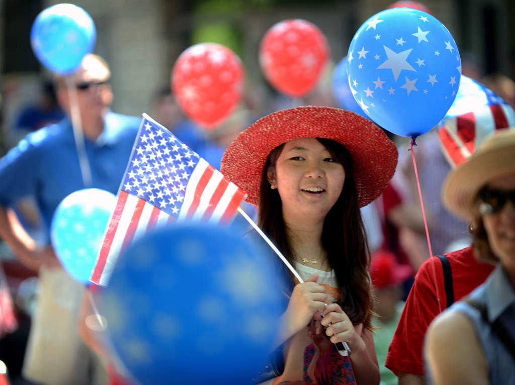 . University of Minnesota College of Veterinary Medicine student Xi Guo waits to march in the St. Anthony Park parade. She is from Beijing and in her second year of her doctoral program.  (Pioneer Press: Chris Polydoroff)