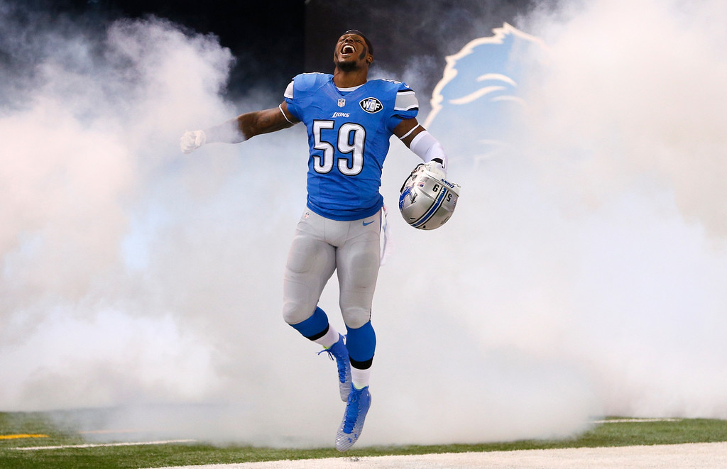 . Detroit Lions outside linebacker Tahir Whitehead is introduced before the first half of an NFL football game against the Green Bay Packers in Detroit, Sunday, Sept. 21, 2014. (AP Photo/Rick Osentoski)