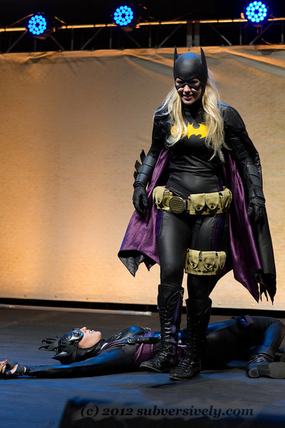 Batgirl (Marisha Ray) walks away from her win vs. Catwoman (Robin Sol).