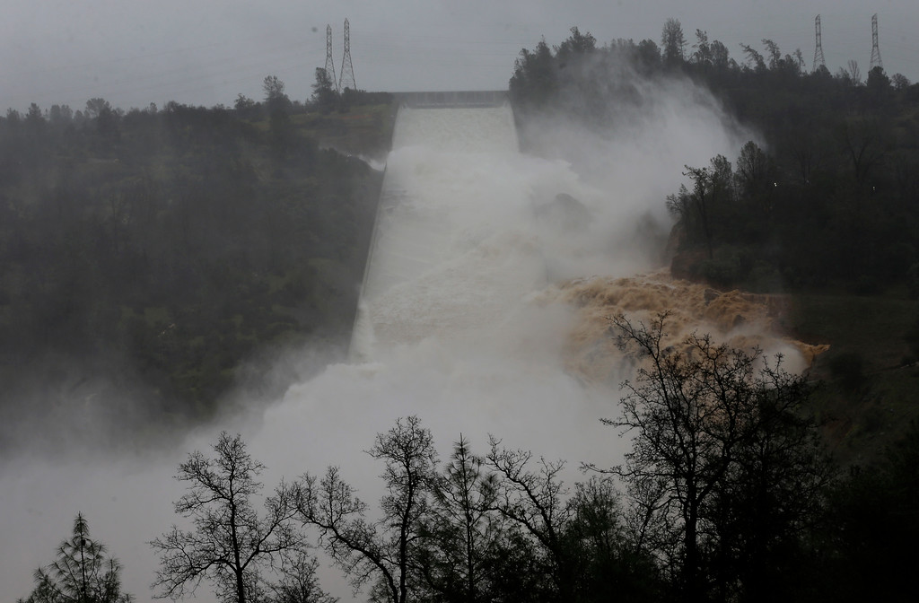 . Water rushes down the Oroville Dam spillway, Thursday, Feb. 9, 2017, in Oroville, Calif. State engineers on Thursday discovered new damage to the Oroville Dam spillway, the tallest in the United States, though they said there is no harm to the nearby dam and no danger to the public. Earlier this week, chunks of concrete went flying off the spillway, creating a 200-foot-long, 30-foot deep hole. (AP Photo/Rich Pedroncelli)