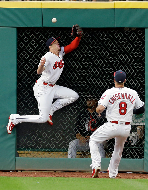 . Cleveland Indians\' Bradley Zimmer jumps but can\'t get to a one-run triple hit by San Diego Padres\' Jose Pirela in the fifth inning of a baseball game, Wednesday, July 5, 2017, in Cleveland. Luis Torrens scored on the play. Lonnie Chisenhall watches.(AP Photo/Tony Dejak)