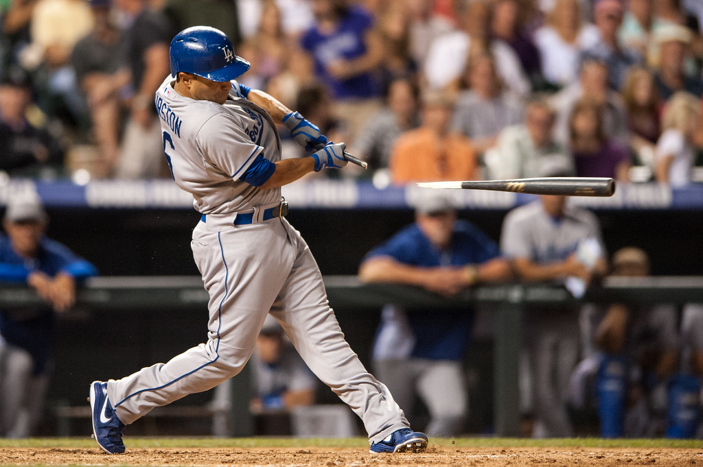 . DENVER, CO - JULY 4:  Jerry Hairston Jr. #6 of the Los Angeles Dodgers hits a pinch-hit broken bat double in the eighth inning of a game against the Colorado Rockies at Coors Field on July 4, 2013 in Denver, Colorado.  The Rockies beat the Dodgers 9-5. (Photo by Dustin Bradford/Getty Images)
