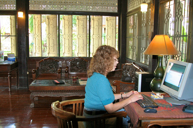In the main house at the computer