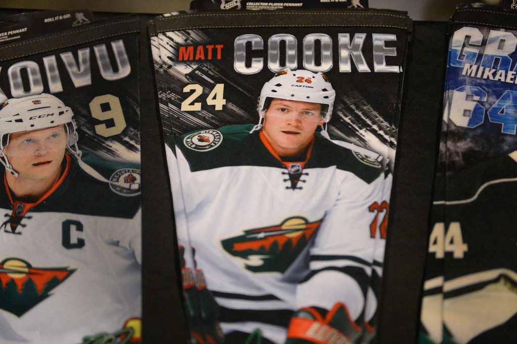 . He won\'t be on the ice due to a seven-game suspension from the NHL but the image of Minnesota Wild wing Matt Cooke was present on pennants for sale inside the arena Thursday night.   (Photo by Karl Gehring/The Denver Post)