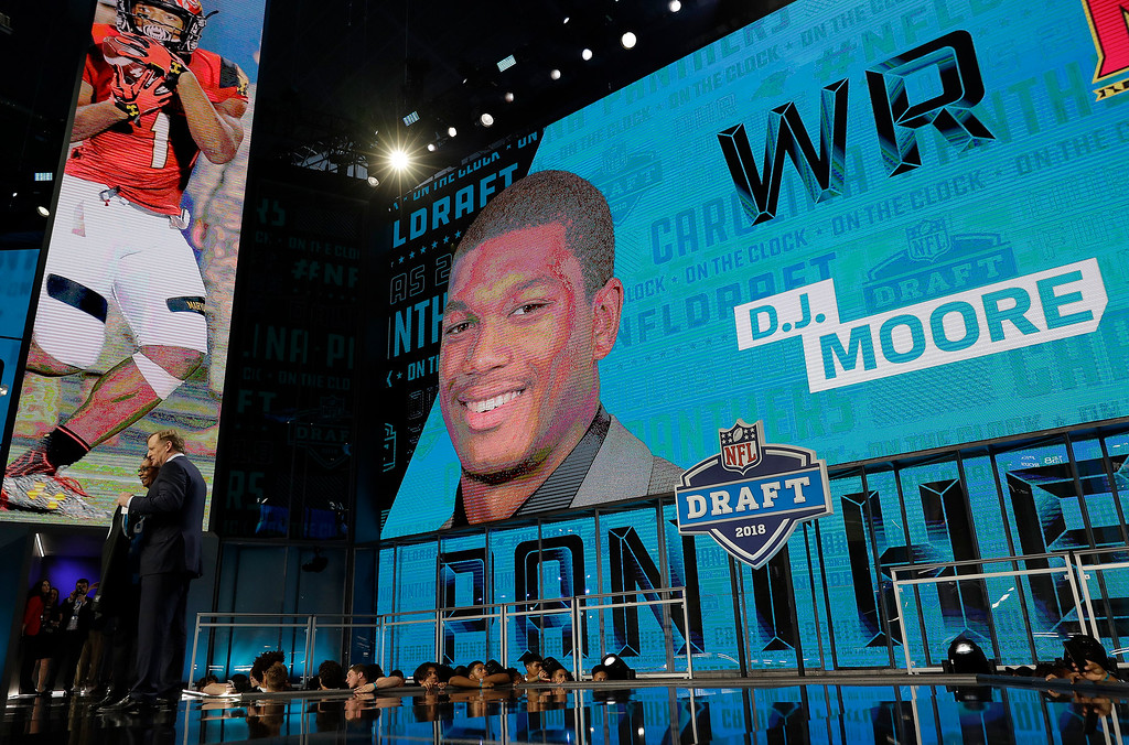 . Commissioner Roger Goodell poses with a fan after the Carolina Panthers selected D.J. Moore during the first round of the NFL football draft, Thursday, April 26, 2018, in Arlington, Texas. (AP Photo/David J. Phillip)