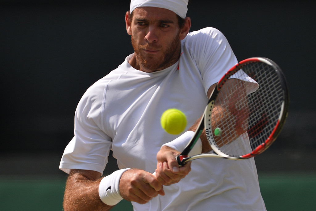 . Argentina\'s Juan Martin Del Potro returns against Serbia\'s Novak Djokovicduring their men\'s singles semi-final match on day eleven of the 2013 Wimbledon Championships tennis tournament at the All England Club in Wimbledon, southwest London, on July 5, 2013. CARL COURT/AFP/Getty Images