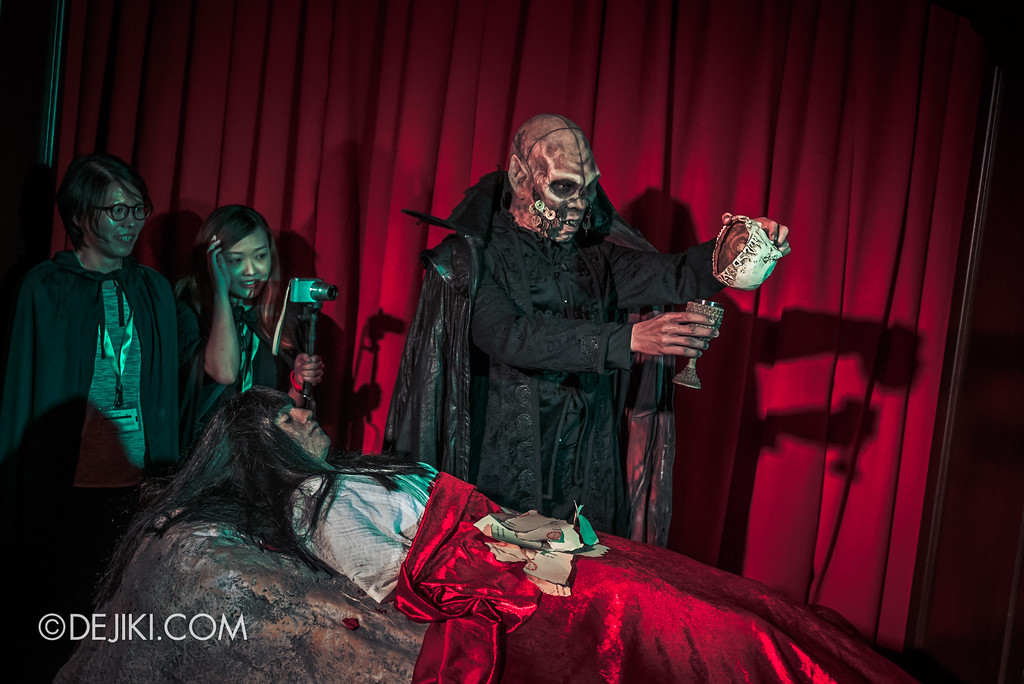 Halloween Horror Nights 8 Press Conference - Killuminati Haunted House - Lu Xi Fa pours blood from skull into chalice