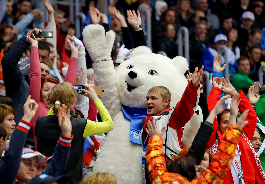 . Hockey fans do the wave during a time out in the second period of a men\'s ice hockey game between the Czech Republic and Sweden at the 2014 Winter Olympics, Wednesday, Feb. 12, 2014, in Sochi, Russia. (AP Photo/Mark Humphrey)