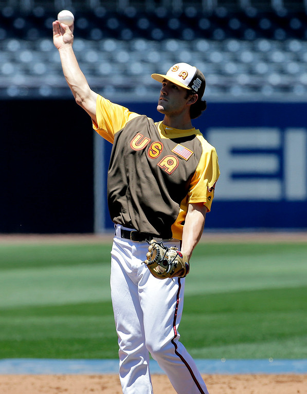 . U.S. Team\'s Dansby Swanson, of the Atlanta Braves, warms up prior to the All-Star Futures baseball game against the World team, Sunday, July 10, 2016, in San Diego. (AP Photo/Matt York)