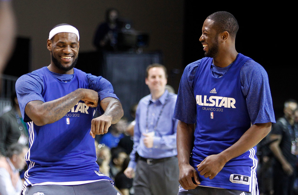 . Miami Heat\'s LeBron James, left, does a dance move as he stands with teammate Dwyane Wade during practice for the NBA All Star basketball game, Saturday, Feb. 25, 2012, in Orlando, Fla. (AP Photo/Lynne Sladky)