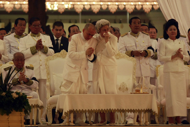 . Cambodia\'s King Norodom Sihamoni (centre L) and Queen Monique (centre R) cry during the cremation of the late former King Norodom Sihanouk, near the Royal Palace in Phnom Penh on February 4, 2013. Thousands of mourners massed in the Cambodian capital as the kingdom cremated its revered former King Norodom Sihanouk, who steered his country through six turbulent decades. AFP PHOTO/ KHEM  SOVANNARA/AFP/Getty Images