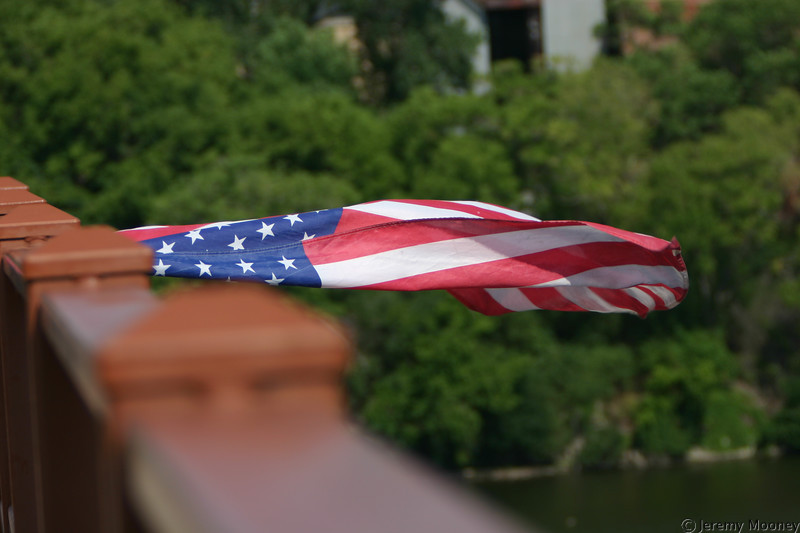 Flag hung from the south/east side of the Stone Arch Bridge.