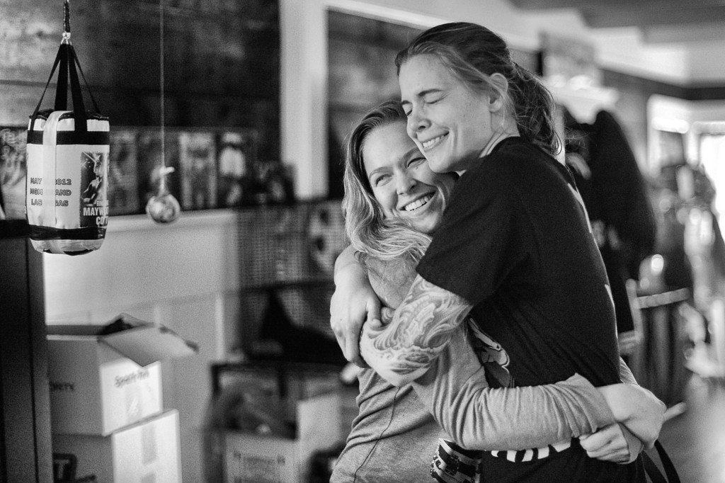 . Ronda Rousey gets a hug from housemate Jessamyn Duke at their Venice home. (Photo by Hans Gutknecht/Los Angeles Daily News)