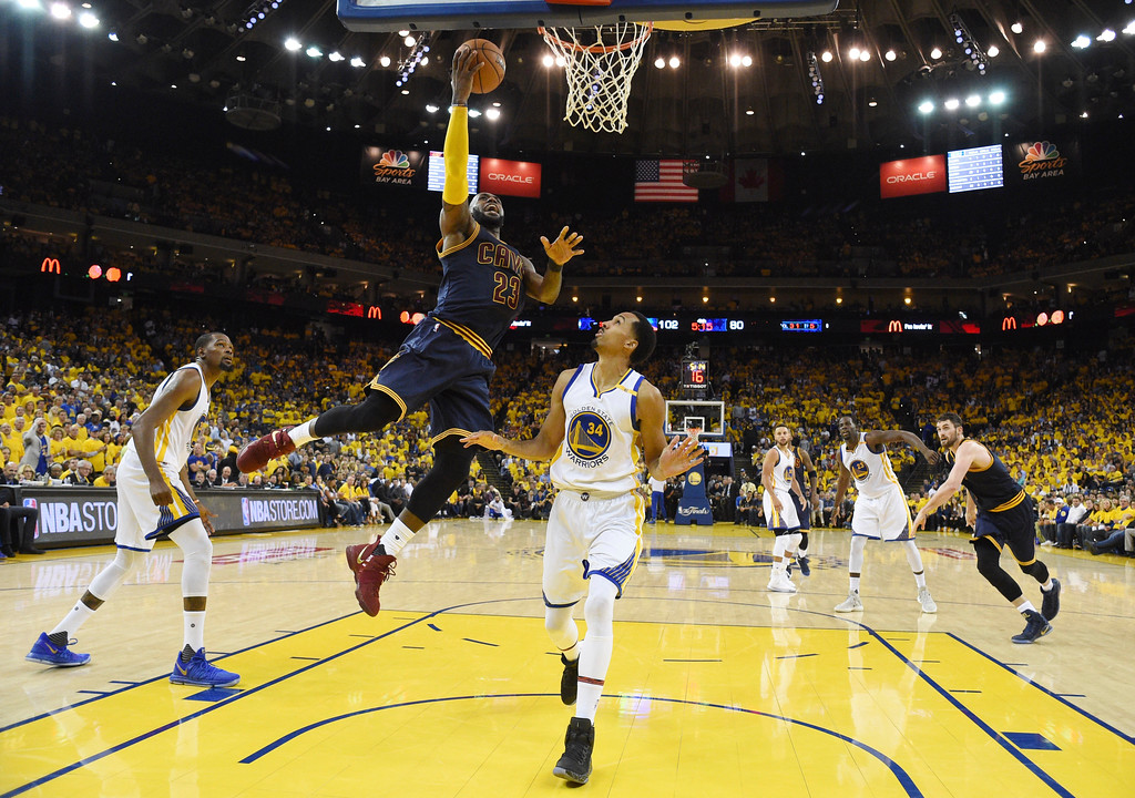. Cleveland Cavaliers forward LeBron James (23) shoots against Golden State Warriors guard Shaun Livingston (34) during the second half of Game 1 of basketball\'s NBA Finals in Oakland, Calif., Thursday, June 1, 2017. (Kyle Terada/Pool Photo via AP)