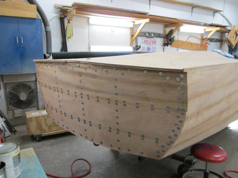 Transom planks epoxied in place held with temporary fasteners.